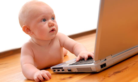 infant baby using laptop computer