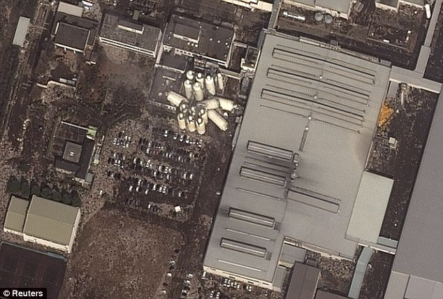 Damage: This satellite image shows towers that have collapsed at the Kirin plant in Sendai