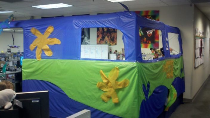 A crazy wall of fabric put up around a cubicle at Zappos